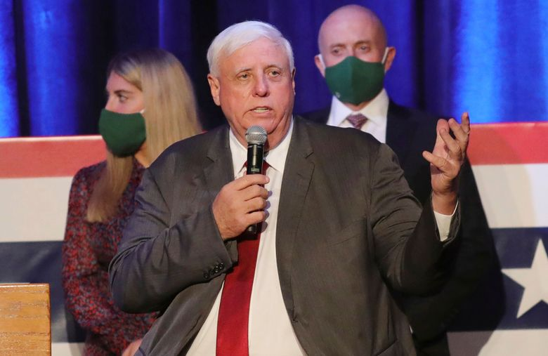 """FILE – In this Nov. 3, 2020, file photo, West Virginia Gov. Jim Justice celebrates his reelection at The Greenbrier Resort in White Sulphur Springs, W.Va. Active coronavirus cases in West Virginia continue to resurge at an alarming rate as public school students in some counties returned Monday, Aug. 9, 2021, for the start of fall classes. Justice said the rate of cases are """"probably going to continue to get tougher in the weeks ahead."""" (AP Photo/Chris Jackson, File)"""