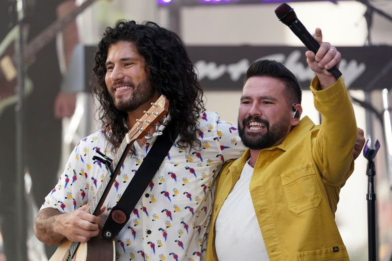 """FILE – Dan Smyers, left, and Shay Mooney from the duo Dan + Shay perform on NBC's """"Today"""" show at Rockefeller Plaza on Friday, July 16, 2021, in New York.  Country duo Dan + Shay reached global audiences with songs like """"10,000 Hours"""" with Justin Bieber and """"Tequila."""" But the pandemic taught the Grammy-winning pair to slow down and reflect.  (Photo by Charles Sykes/Invision/AP)"""