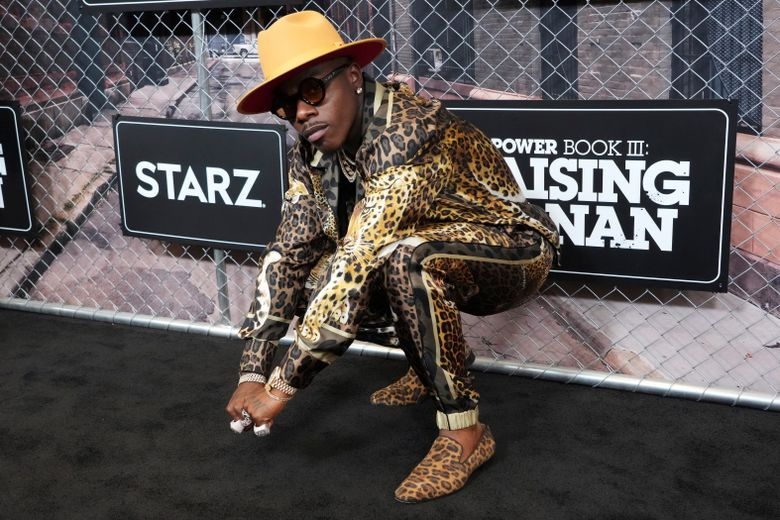 """FILE – DaBaby attends the world premiere of """"Power Book III: Raising Kanan"""" at the Hammerstein Ballroom on Thursday, July 15, 2021, in New York. DaBaby was cut Sunday, Aug. 1, 2021 from Lollapalooza's closing lineup following crude and homophobic remarks he made last week at a Miami-area music festival. (Photo by Charles Sykes/Invision/AP)"""