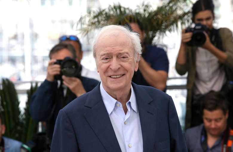 FILE – In this Wednesday, May 20, 2015 file photo, Michael Caine poses for photographers during a photo call for the film Youth, at the 68th international film festival, Cannes, southern France. The international film festival returns to the Czech spa of Karlovy Vary after two years due to a delay caused by the coronavirus pandemic. The 55th edition of the fest will honor English Oscar-winning English actor Michael Caine for his outstanding contribution to world cinema at its start on Friday, Aug, 20, 2021.(AP Photo/Lionel Cironneau, file)