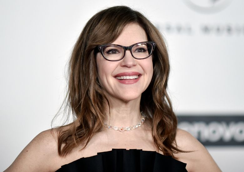 """FILE – Grammy Award-winner Lisa Loeb attends the Universal Music Group 2020 Grammy after party in Los Angeles on Jan. 26, 2020. Loeb was inspired to capture the weirdness, wonder and horror of 2020 during a Brown University online reunion. She tapped dozens of her fellow alumni to create """"Together Apart,"""" a collection of 10 mini-musicals that capture a year online. (Photo by Richard Shotwell/Invision/AP, File"""