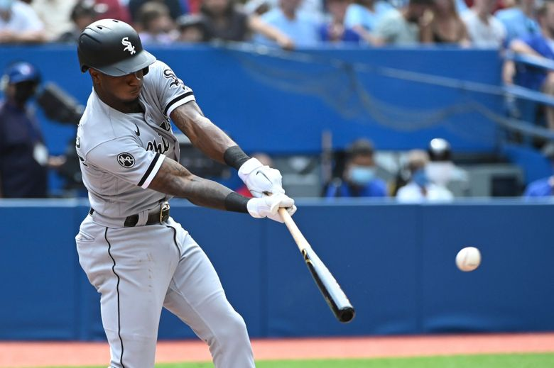 Chicago White Sox's Luis Robert hits a two-run home run in the third inning of a baseball game against the Toronto Blue Jays in Toronto on Thursday, Aug. 26, 2021. (Jon Blacker/The Canadian Press via AP)