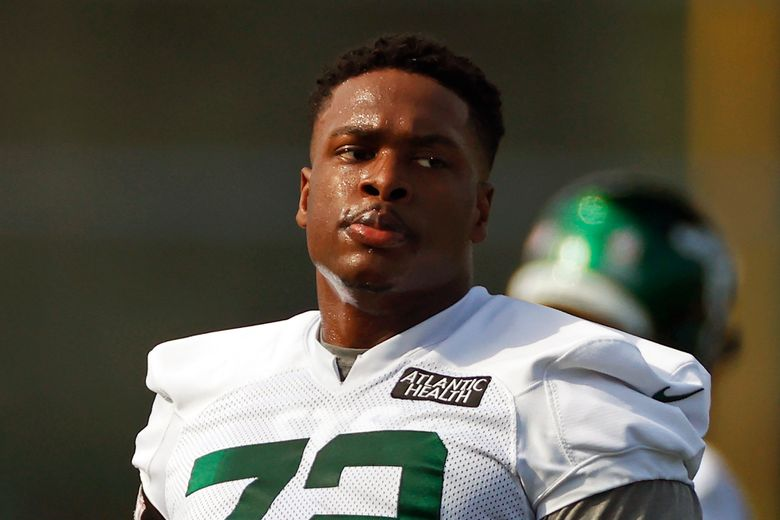 FILE – New York Jets offensive tackle Cameron Clark (72) is shown during a practice at the NFL football team's training camp in Florham Park, N.J., in this Saturday, Aug. 22, 2020, file photo. Jets second-year offensive lineman Cameron Clark was taken to a hospital by ambulance after injuring his neck late in practice Tuesday, Aug. 3, 2021. (AP Photo/Adam Hunger, File)