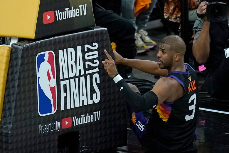 Phoenix Suns guard Chris Paul gestures during the first half of Game 5 of basketball's NBA Finals against the Milwaukee Bucks, Saturday, July 17, 2021, in Phoenix. (AP Photo/Ross D. Franklin)