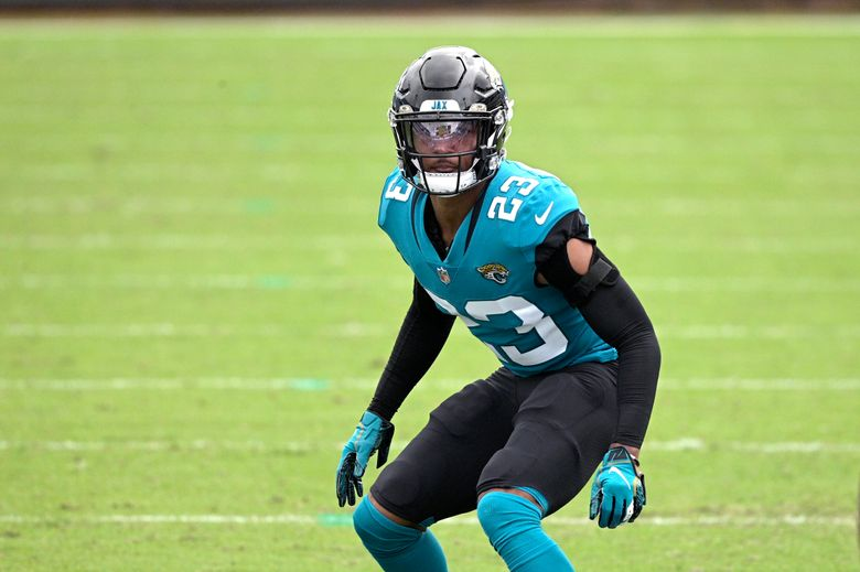 """FILE – Jacksonville Jaguars cornerback CJ Henderson (23) follows a play during the second half of an NFL football game against the Houston Texans in Jacksonville, in this Sunday, Nov. 8, 2020, file photo. Henderson hasn't been the same since a shoulder injury last October. New coach Urban Meyer raved about Henderson's rehab in March and said """"we're counting on him."""" But Meyer's faith in Henderson seems to be waning. (AP Photo/Phelan M. Ebenhack, File)"""