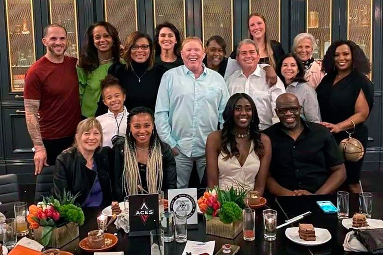 This photo provided by Sylvia Crawley Spann, shows former WNBA player Sylvia Crawley Spann and her husband Brian, seated bottom right, celebrating their wedding with Las Vegas Aces WNBA basketball team owner Mark Davis, standing at center, and other former members of the franchise and their guests at a restaurant in Las Vegas on May 29, 2021. Mark Davis has already left his imprint on the Las Vegas Aces franchise in his first year as the team's owner, connecting it's past to the present. Davis has been inviting back alums of the franchise dating to its time in Utah and San Antonio. (Sylvia Crawley Spann via AP)