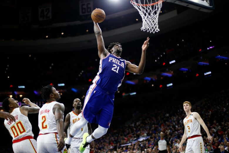 FILE – Philadelphia 76ers' Joel Embiid (21) goes up for a dunk during the second half of an NBA basketball game against the Atlanta Hawks in Philadelphia, in this Monday, Feb. 24, 2020, file photo. The 76ers have kept their trust in Joel Embiid .A person familiar with the situation told The Associated Press Embiid and the Sixers agreed on a four-year, $196 million contract extension that will take the All-Star center through the 2026-2027 season. The person spoke  on condition of anonymity because the deal was not expected to be formally announced later Tuesday, Aug. 17, 2021. (AP Photo/Matt Slocum, File)