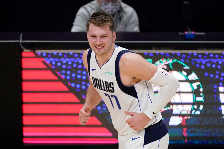 FILE – In this May 22, 2021, file photo, Dallas Mavericks guard Luka Doncic smiles after scoring during the first half in Game 1 of an NBA basketball first-round playoff series against the Los Angeles Clippers in Los Angeles. Doncic is set to sign a $207 million supermax extension with the Mavericks, who sent an entourage to the Slovenian star's home country to finish off the biggest contract in franchise history. (AP Photo/Mark J. Terrill, File)