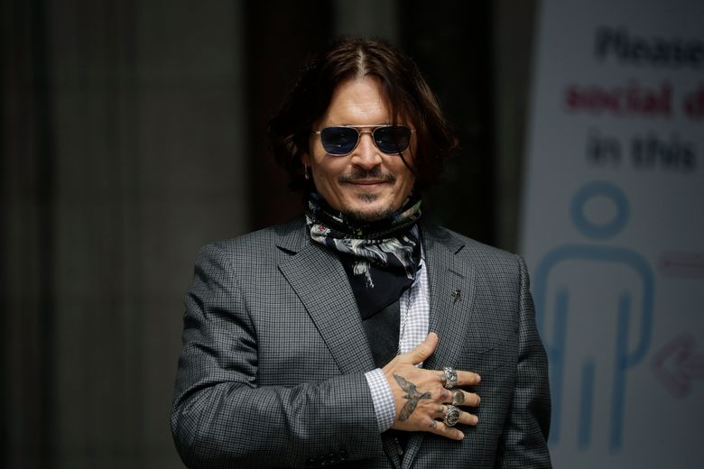 """FILE – In this Thursday, July 23, 2020 file photo, U.S. actor Johnny Depp gestures to fans and the media as he arrives at the High Court in London. Spain's most high-profile group of female filmmakers denounced the San Sebastian film festival's decision to award Johnny Depp its highest honor for acting on Monday Aug. 9, 2021. The move gives the festival a bad name after a British judge ruled allegations of domestic violence against Depp were """"substantially correct"""", it says. (AP Photo/Matt Dunham, file)"""