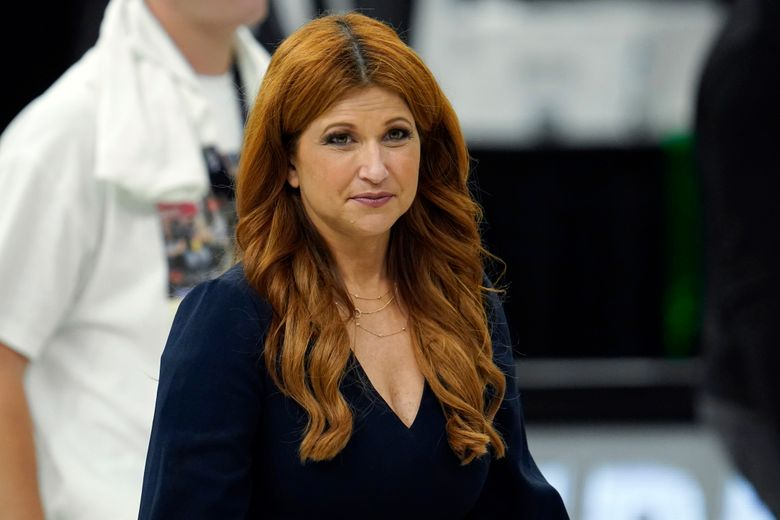 """FILE – In this July 20, 2021, file photo, ESPN reporter Rachel Nichols walks on the court after Game 6 of basketball's NBA Finals between the Milwaukee Bucks and Phoenix Suns in Milwaukee. ESPN is cancelling Nichols' """"The Jump"""" show and pulling her off NBA programming. (AP Photo/Paul Sancya, File)"""