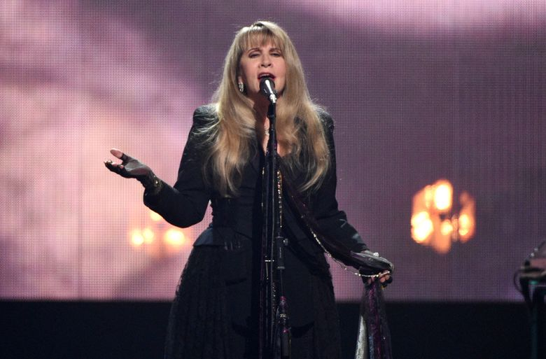 FILE – Inductee Stevie Nicks performs at the Rock & Roll Hall of Fame induction ceremony on March 29, 2019, in New York. Nicks canceled appearances at five music festivals where she had planned performances, citing coronavirus concerns. (Photo by Evan Agostini/Invision/AP, File)