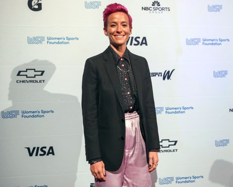 """FILE – Soccer player Megan Rapinoe poses for photos on the red carpet of the Women's Sports Foundation's 40th annual Salute to Women in Sports in New York on Oct. 16, 2019. Rapinoe has selected #MeToo founder Tarana Burke's memoir, """"Unbound,"""" for her new book club. (AP Photo/Mary Altaffer, File)"""