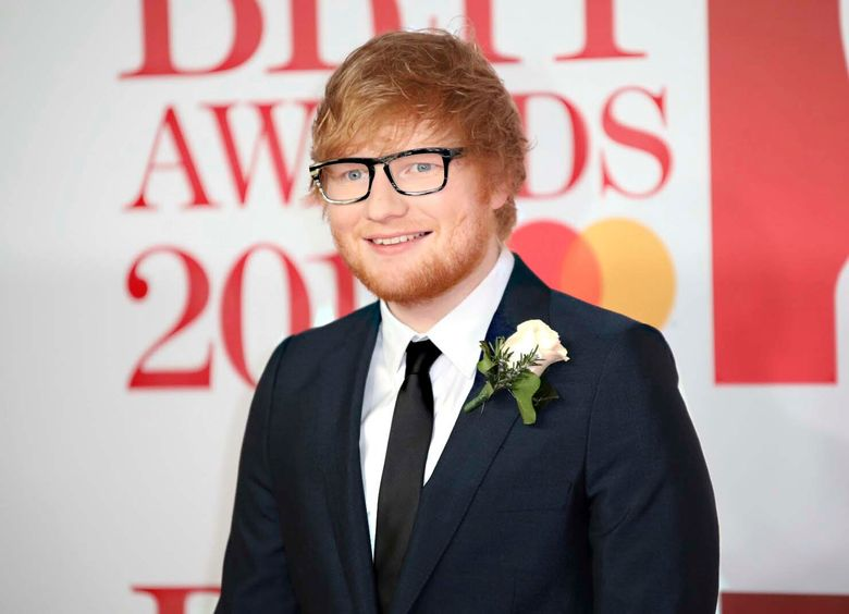 """FILE – In this Feb. 21, 2018 file photo, singer Ed Sheeran poses for photographers upon arrival at the Brit Awards 2018 in London.  Sheeran announced Thursday that his upcoming studio album """"'='"""", which is pronounced """"Equals,"""" will release on Oct. 29.  (Photo by Vianney Le Caer/Invision/AP, File)"""