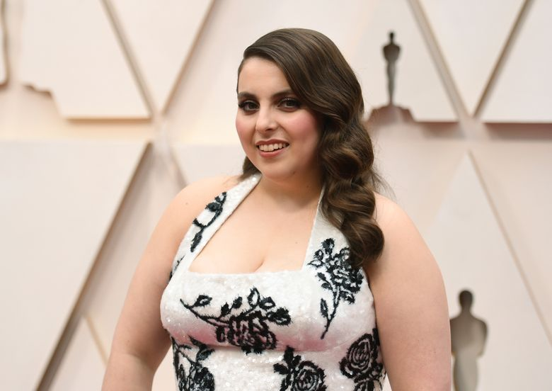 """FILE – Beanie Feldstein arrives at the Oscars on Feb. 9, 2020, in Los Angeles. A Broadway revival of """"Funny Girl"""" is aiming to open next year with Feldstein in the starring role originated by Barbra Streisand. Producers announced Wednesday, Aug. 11, 2021, that the """"Booksmart"""" and """"Lady Bird"""" actor will star as Ziegfeld Follies comedian Fanny Brice in spring 2022 at a Broadway theater to be announced. (Photo by Richard Shotwell/Invision/AP, File)"""