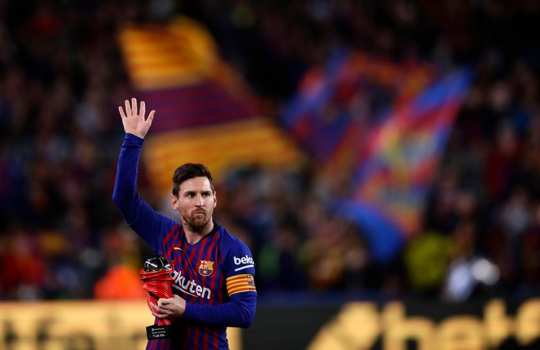 """FILE – In this Saturday, April 6, 2019 file photo, Barcelona forward Lionel Messi waves at the crowd as he holds the trophy of the best Spanish La Liga player prior to a soccer match between FC Barcelona and Atletico Madrid at the Camp Nou stadium in Barcelona, Spain. Barcelona says Lionel Messi will not stay with the club, it was reported on Aug. 5, 2021 in a statement that a deal between the club and the player had been reached but financial """"obstacles"""" made it impossible for the player to remain with the club.  (AP Photo/Manu Fernandez, File)"""