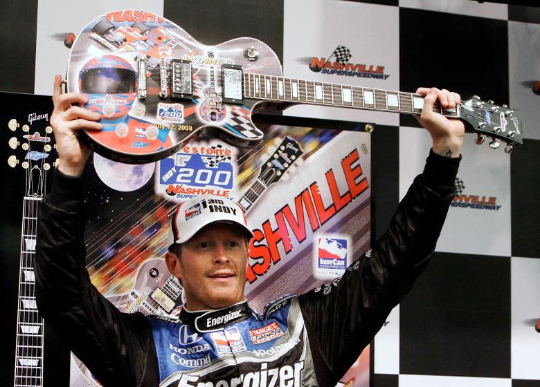 FILE – In this July 12, 2008, file photo, Scott Dixon, of New Zealand, holds his guitar trophy after winning the rain-shortened IndyCar Series auto race in Gladeville, Tenn. The IndyCar series race will be held in downtown Nashville, Tenn., this weekend. (AP Photo/Mark Humphrey, File)