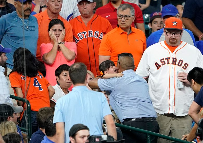 FILE – In this May 29, 2019, file photo, a young child is carried from the stands after being injured by a foul ball off the bat of Chicago Cubs' Albert Almora Jr. during the fourth inning of a baseball game against the Houston Astros in Houston. The Astros have agreed to a settlement with the family of the 2-year-old girl struck by a foul ball during the game at Minute Maid Park, the family's attorney said Monday, Aug. 16, 2021. (AP Photo/David J. Phillip, File)