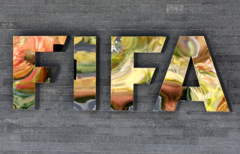 FILE – in this Sept. 25, 2015 file photo, the International Federation of Association Football,  FIFA, logo is fixed on a wall of its headquarters during a meeting of the FIFA Executive Committee in Zurich, Switzerland. Reynaldo Vasquez, the former president of the El Salvador Soccer Federation declared himself guilty on Monday, August 23, 2021, before a judge in New York, of money laundering and electronic fraud charges in a corruption scandal that has shaken FIFA since 2015. (AP Photo/Michael Probst, File)