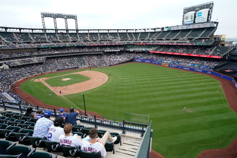 New York Mets fans watch a baseball game against the Washington Nationals during the seventh inning, Sunday, Aug. 29, 2021, in New York. (AP Photo/Corey Sipkin)