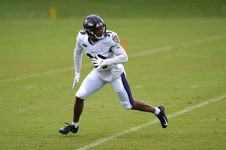 Baltimore Ravens safety Nigel Warrior works out during the 2020 camp in Owings Mills, Md. (Julio Cortez / AP)