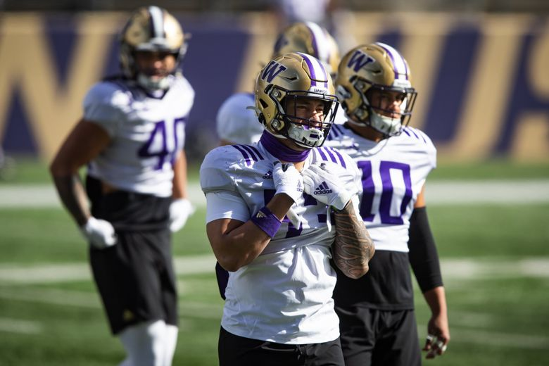 Linebacker MJ Tafisi lines up with his unit as the University of Washington Huskies participate in their spring practice, April 10, 2021 in Seattle. (Bettina Hansen / The Seattle Times)