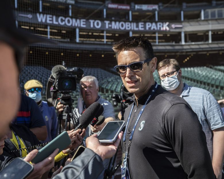 Mariners president of baseball operations Jerry Dipoto discusses his new multi-year contract extension near home plate at T-Mobile Park on Wednesday, Sept. 1, 2021. (Steve Ringman / The Seattle Times)