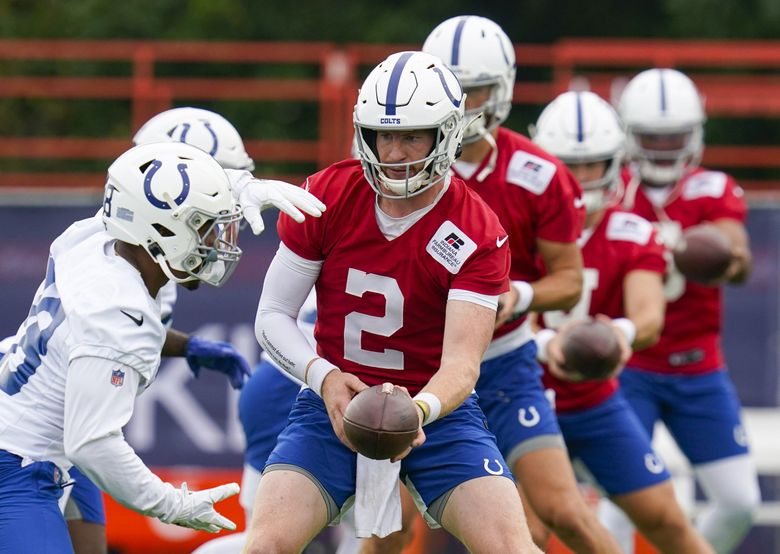 Indianapolis Colts quarterback Carson Wentz runs a drill during practice at the NFL team's football training camp in Westfield, Ind., Wednesday, July 28, 2021. (Michael Conroy / AP)
