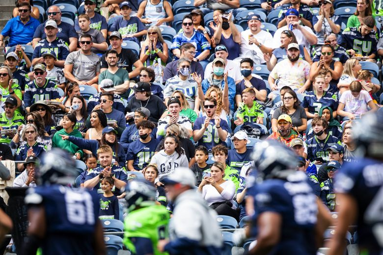 Fans cheer before the Seahawks play a mock game as part of training camp at Lumen Field in Seattle, Aug. 8, 2021. (Bettina Hansen / The Seattle Times)