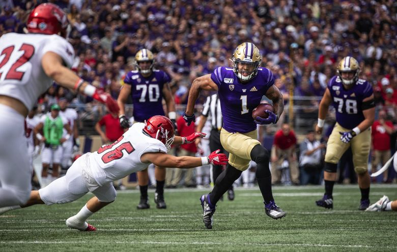 Washington receiver Hunter Bryant presses to the 27 on a 7-yard pass reception during the 2019 season opening game against Eastern Washington University in Seattle. (Dean Rutz / The Seattle Times)