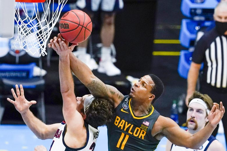 Baylor guard Mark Vital blocks a shot by Gonzaga forward Corey Kispert during the NCAA championship game in the men's Final Four tournament in Indianapolis, April 5, 2021. (Michael Conroy / AP)