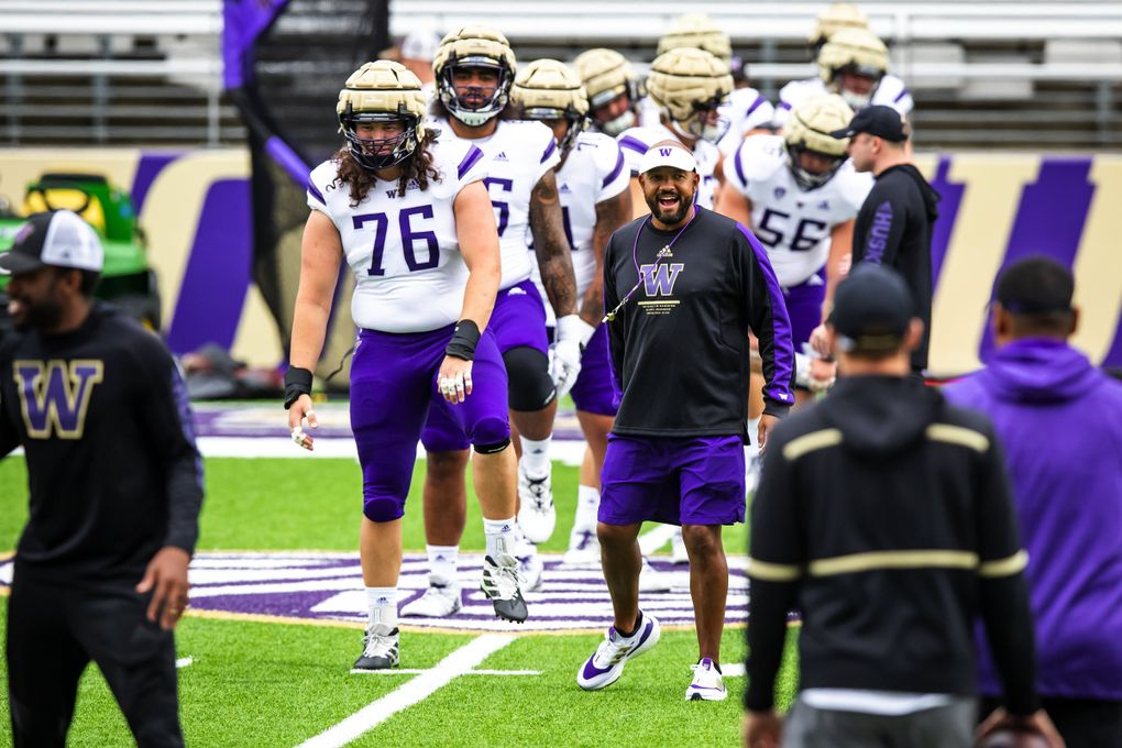Huskies head football coach Jimmy Lake watches warmups for a scrimmage at Husky Stadium in Seattle, Aug. 21, 2021. (Bettina Hansen / The Seattle Times)
