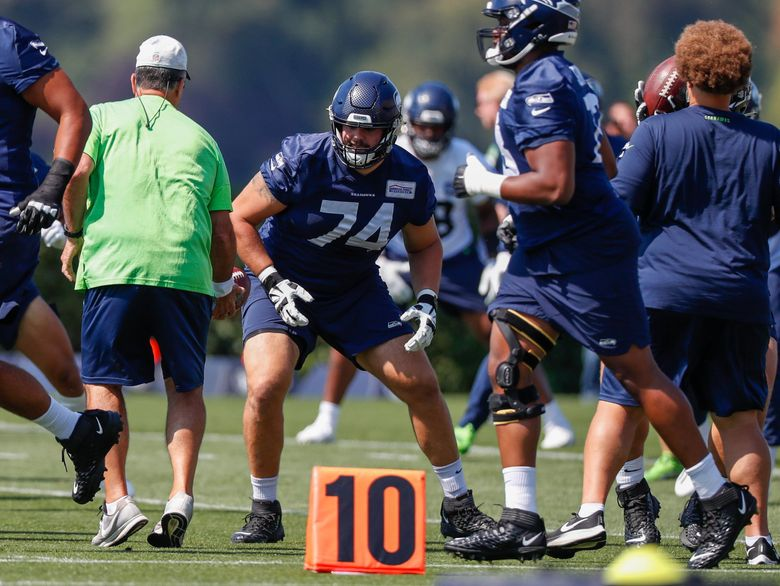 Seattle Seahawks offensive tackle Jake Curhan participates in drills during training camp on Tuesday, Aug. 24, 2021, in Renton, Wash. (Jennifer Buchanan / The Seattle Times)