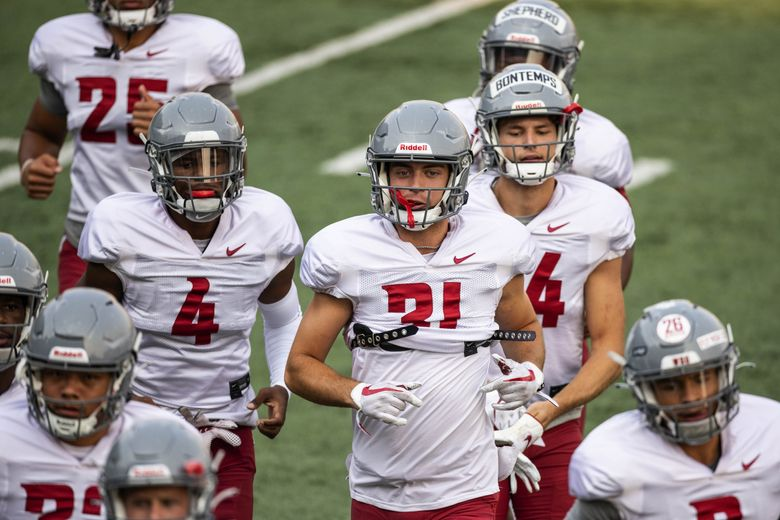 Washington State defensive backs gather for practice, Aug. 12, 2021 at Rogers Field in Pullman. (Dean Rutz / The Seattle Times)