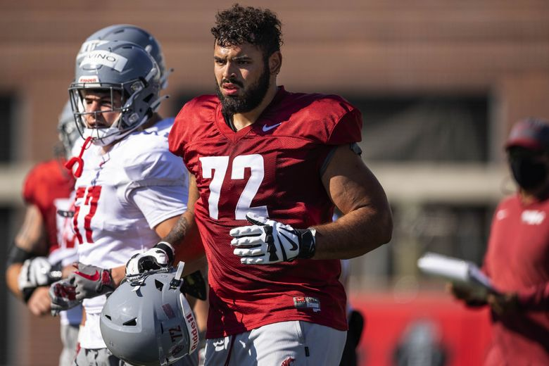 Washington State offensive lineman Abraham Lucas practices, Aug. 11, 2021 at Rogers Field in Pullman. (Dean Rutz / The Seattle Times)