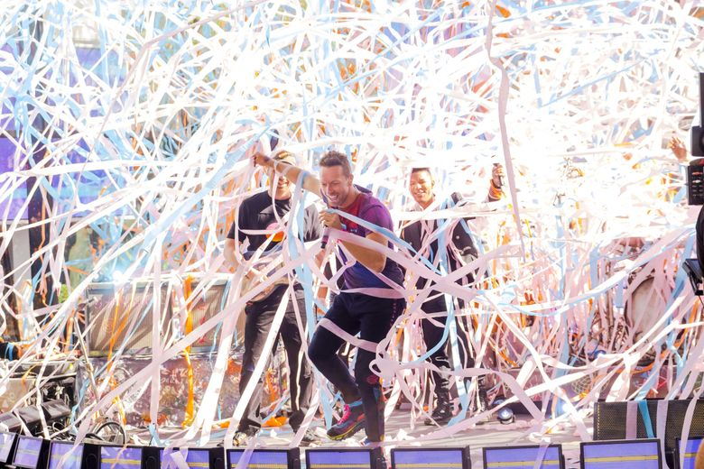 """Chris Martin from the band Coldplay performs on NBC's """"Today"""" show in New York in June 17. Coldplay will be the first act to play the new Climate Pledge Arena in Seattle. (Charles Sykes / Invision / AP, file)"""