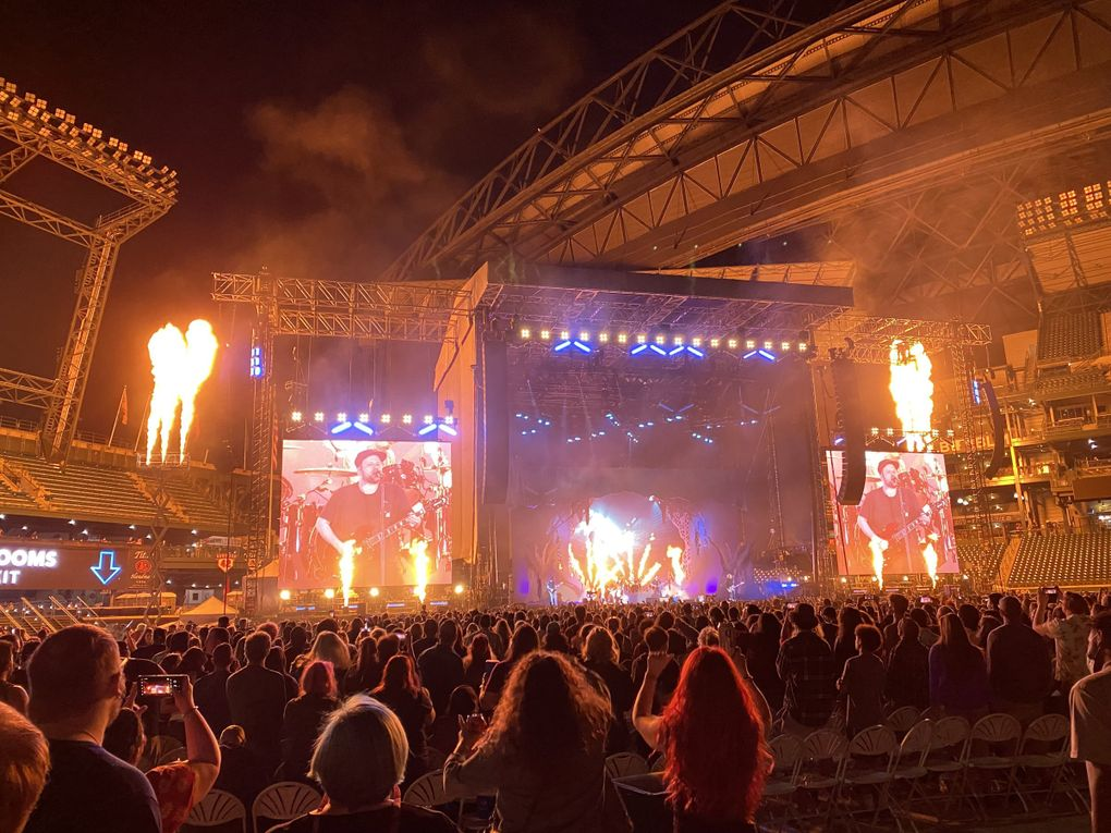 Fall Out Boy gives a fiery performance during the Hella Mega tour with Green Day and Weezer at Seattle's T-Mobile Park Monday. (Michael Rietmulder / The Seattle Times)
