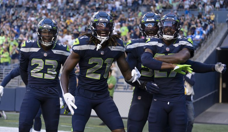 Seattle Seahawks, from left, defensive back Damarious Randall, defensive back Tre Flowers, defensive end Darrell Taylor and defensive back Marquise Blair celebrate a touchdown during a preseason game against the Los Angeles Chargers, Aug. 28, 2021, in Seattle. (Stephen Brashear / The Associated Press)