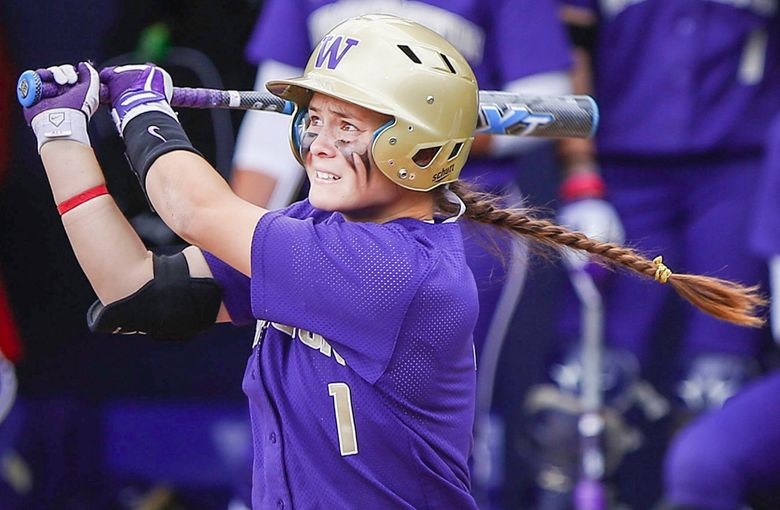 Ali Aguilar watches her solo home run sail towards the fences as  during an NCAA regional tournament game at the Husky Softball Stadium on Saturday, May 17, 2014. (Lindsey Wasson / The Seattle Times)