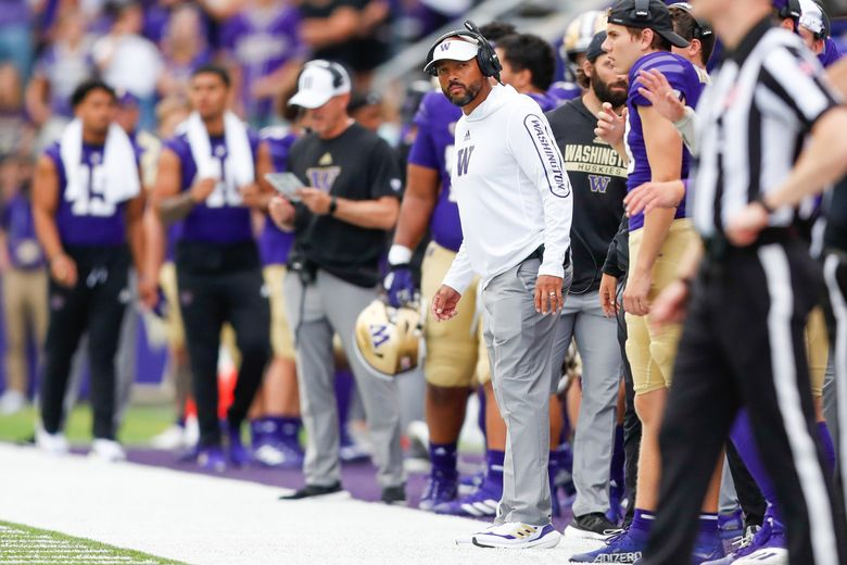 Washington Huskies head coach Jimmy Lake looks down the sidelines during the first quarter against the Montana Grizzlies, Sept. 4, 2021, in Seattle. (Jennifer Buchanan / The Seattle Times)