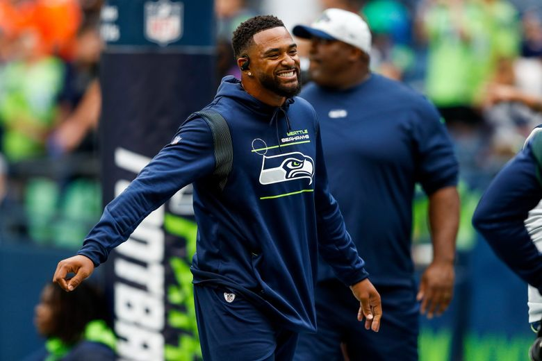 Jamal Adams, Seattle Seahawks safety, enjoys a moment with teammates before the start of a preseason game against the Denver Broncos, Aug. 21, 2021, in Seattle. (Jennifer Buchanan / The Seattle Times)