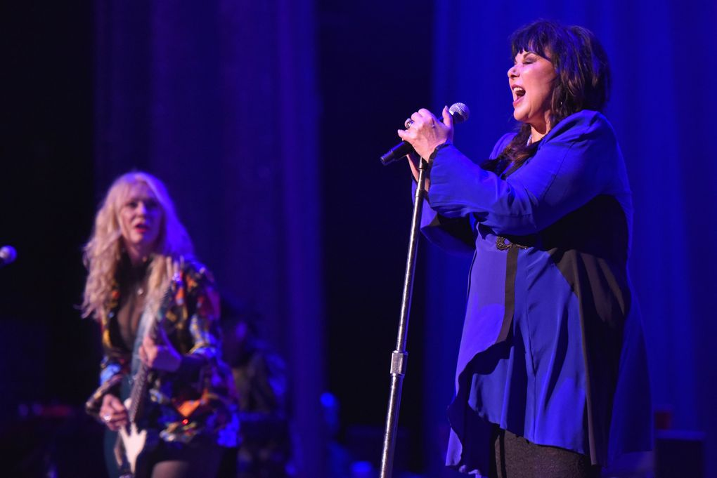 Nancy Wilson, left, is set to play with Seattle Symphony Oct. 30 at Benaroya Hall, while Ann Wilson plays the Neptune Theatre Oct. 13, 16 and 17. (Rob Grabowski / Invision / The Associated Press)
