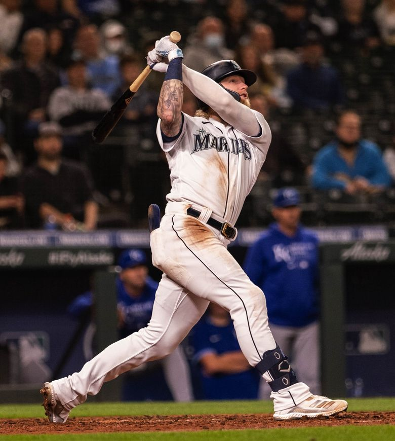Jake Fraley hits a two-run homer capping a three-run inning against the Kansas City Royals Aug. 26, 2021 in Seattle. (Dean Rutz / The Seattle Times)