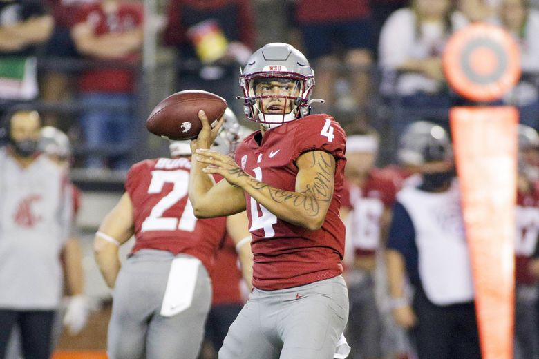 Washington State quarterback Jayden de Laura prepares to throw a pass during a game against Utah State, Sept. 4, 2021, in Pullman, Wash. (Young Kwak / AP)