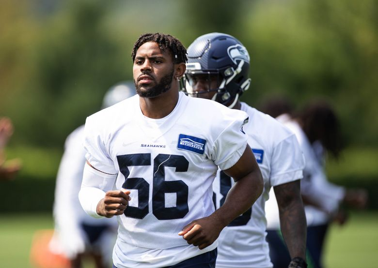 Seahawks linebacker Jordyn Brooks warms up for practice on Aug. 2, 2021, at the VMAC in Renton, Washington. (Dean Rutz / The Seattle Times)