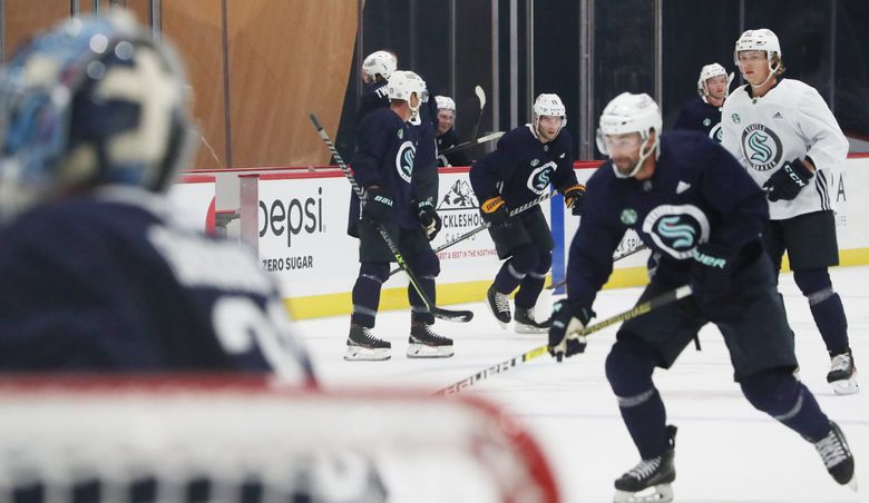 The Seattle Kraken NHL Hockey team is seen on the ice during a 'captain's practice' (no coach) as a special event for VIPs unfolds for the 'venue opening' of the Kraken Community Iceplex, Thursday, Sept 9, 2021 in Seattle's Northgate area. (Ken Lambert / The Seattle Times)