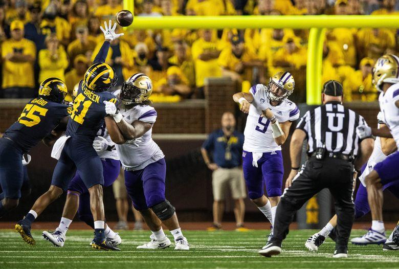 Washington quarterback Dylan Morris attempts a pass Saturday, Sept. 11, 2021 at Michigan Stadium, in Ann Arbor, MI. (Dean Rutz / The Seattle Times)