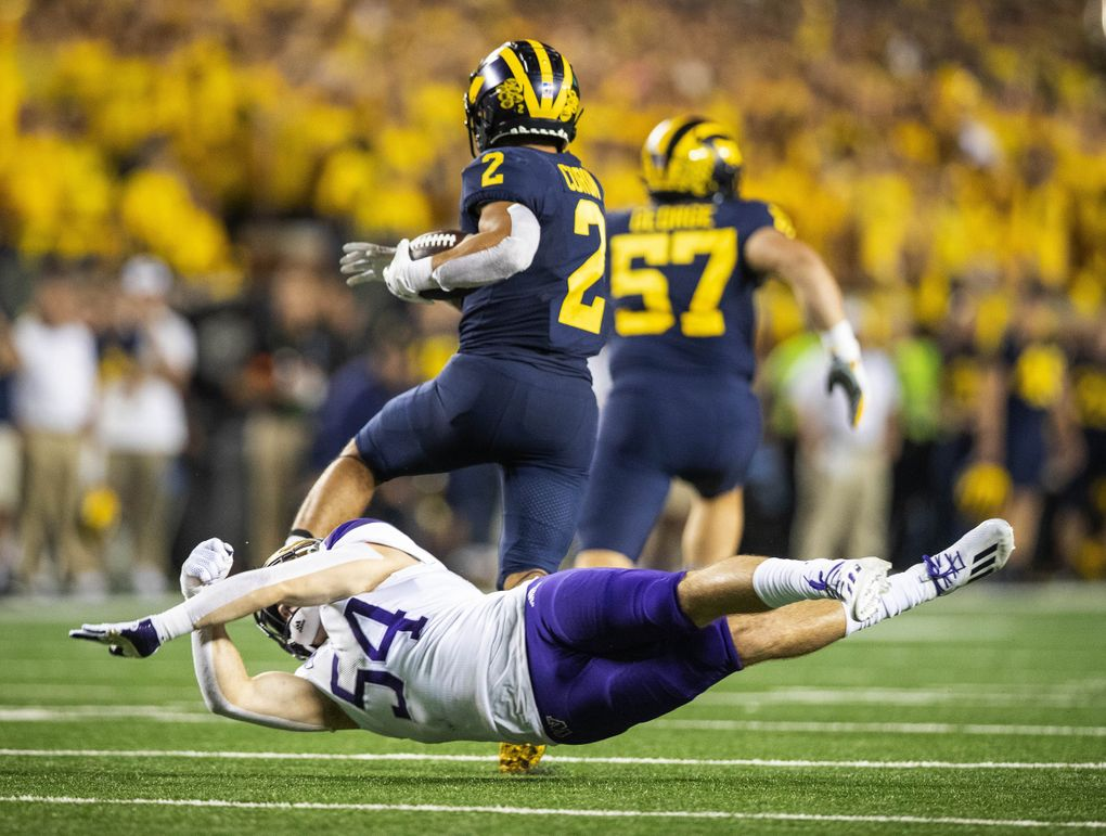 Washington linebacker Drew Fowler completely misses the tackle on Michigan's Blake Corum as the Huskies eventually fell 31-10 to Michigan on Saturday, Sept. 11, 2021 at Michigan Stadium, in Ann Arbor, MI.  Washington lost 31-10. (Dean Rutz / The Seattle Times)