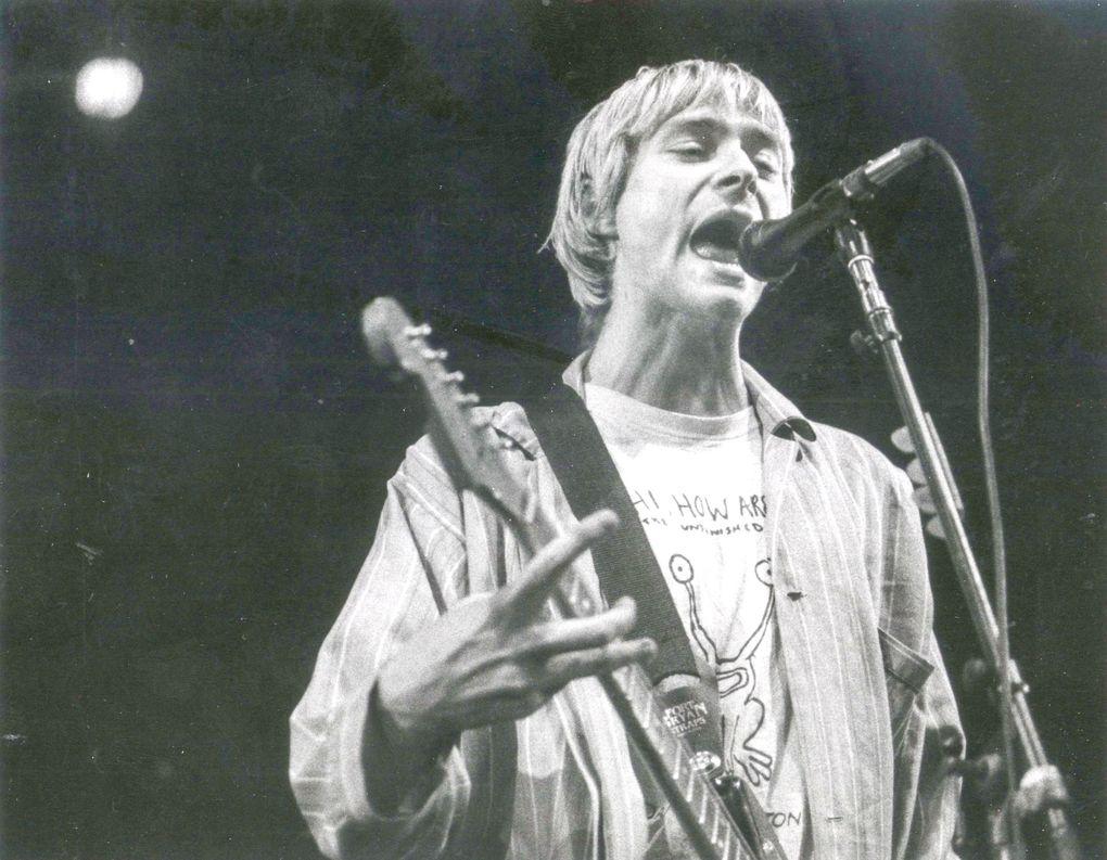 Kurt Cobain belts out a song in Nirvana's 1992 concert at Seattle Coliseum. (Benjamin Benschneider / The Seattle Times)
