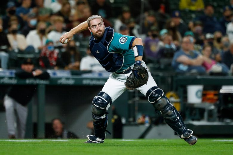 Seattle Mariners catcher Tom Murphy throws to first during a game against the Arizona Diamondbacks, Sept. 10, 2021, in Seattle. (Jennifer Buchanan / The Seattle Times)