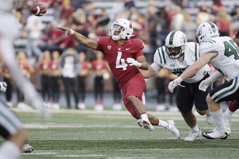 Washington State quarterback Jayden de Laura throws a pass while under pressure by Portland State, Sept. 11, 2021, in Pullman, Wash. (Young Kwak / AP)